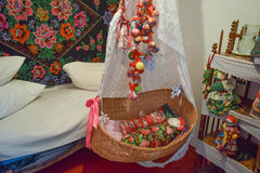 Cradle with dolls in the bedroom. Homemade great toys for children. Recreating the image of antiquity royalty free stock images