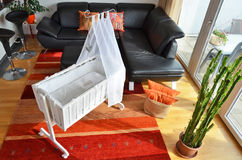 Cradle in the living room. Cradle in the modern living room royalty free stock photography