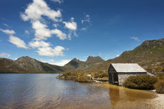 Cradle Mountain. A boathouse sits on the edge of Dove Lake with Cradle Mountain in the background.  Tasmania, Australia Royalty Free Stock Photo