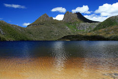 Cradle Mountain and Dove Lake, Tasmania, Australia. Sunny day with clouds over Cradle Mountain with Dove Lake in the foreground in Tasmania Australia Stock Photography