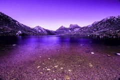 Cradle Mountain mountain lake with a purple and blue split tone. Stock Photo