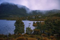 Cradle mountain in Tasmania on a cloudy day. View of a cradle mountain in Tasmania, Australia on a cloudy day stock photos