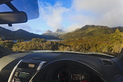 Cradle Mt from car. Australia tasmania cradle mountain national park lake dove car park and 4wd rented vehicle looking at landmarks sunny morning through the Royalty Free Stock Image