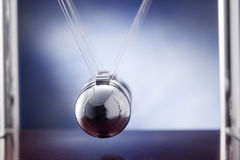 Cradle. Newton's cradle against blue background Royalty Free Stock Images