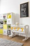 Cradle in nursery. Cute white wooden cradle in white nursery interior Royalty Free Stock Image