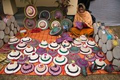 Crafswoman making bamboo hats Stock Photos