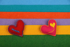 Craft and art two felt hearts on stripes Royalty Free Stock Photo