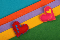 Craft and art two felt hearts on stripes Royalty Free Stock Images