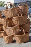 Craft baskets with handles for sale stacked on top of each other stock image