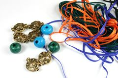 Craft Beads and Cord. Assortment of craft beads and cords on white background Stock Photography