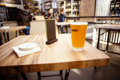 Craft Beer in Bar. Glass on table in authentic Pub Stock Image