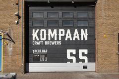 Craft beer brewery and bar Kompaan in indurstrial zone Binckhorst in The Hague known as one of the best in the Netherlands. Craft beer brewery and bar Kompaan stock photography