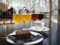 Craft beer, brownie and coffee stock image