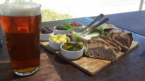 Craft beer and country fare. Craft beer and homemade country food Royalty Free Stock Image