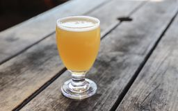 Craft Beer Glass. A Craft Beer from a Local Brewery on a Table royalty free stock images