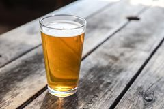 Craft Beer Glass. A Craft Beer Pint from a Local Brewery on a Table stock photo