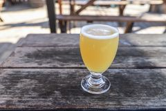 Craft Beer Glass. A Craft Beer from a Local Brewery on a Table royalty free stock image