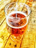 Craft beer. Local craft beer served in a glass on a wooden table royalty free stock photography