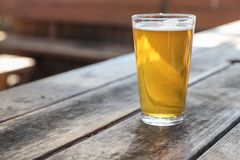 Craft Beer Glass. A Craft Beer Pint from a Local Brewery on a Table stock photos