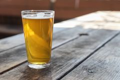 Craft Beer Glass. A Craft Beer Pint from a Local Brewery on a Table royalty free stock photos