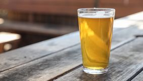 Craft Beer Glass. A Craft Beer Pint from a Local Brewery on a Table stock photography