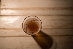 Craft beer on a table in the pub. Craft beer in a pub, on a table, blured background, focus on glass stock image