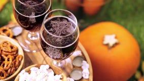 Craft beer. Craft pumpkin beer in beer glasses with salty pretzels and popcorn stock video footage