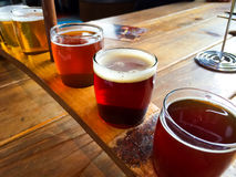 Craft Beer Sampler. Craft beers are served together in a sampler tray for the beer enthusiast at a restaurant in Oregon Stock Photo