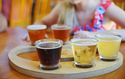 Craft Beer Sampler. Craft beers are served together in a sampler tray for the beer enthusiast at a restaurant in Perth Royalty Free Stock Images