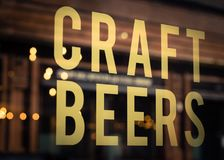 Craft Beer Sign in Brewery Window. Craft Beers Sign in Pub Window With Reflection of Lights in Glasgow,  Scotland Stock Photography