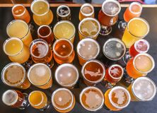 Craft Beer Tasting Flight. A Craft Beer Tasting Flight Sample of Three Beers Are On Display royalty free stock photo