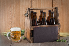 Craft beer from a wooden box. Stock Images