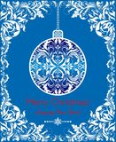 Craft blue greeting for winter holidays with decorative cut out floral border and hanging ball. Craft blue greeting card for winter holidays with decorative cut Stock Images