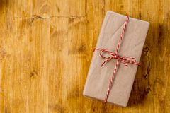 Craft christmas presents on wooden background stock photos