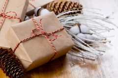 Craft christmas presents on wooden background stock photography