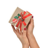 Craft christmas rustic birthday present gift in hands with bear Royalty Free Stock Images