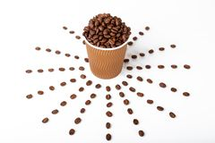 Craft coffee cup full of coffee bean on white background stock images