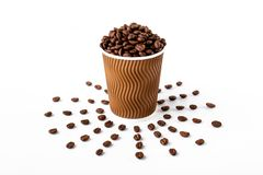 Craft coffee cup full of coffee bean on white background stock photo