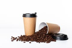 Craft coffee cup full of coffee bean on white background stock photos