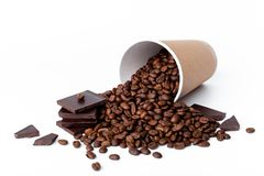 Craft coffee cup full of coffee beans wih chocolate on white background royalty free stock photos