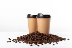 Craft coffee cups and coffee beans on white background stock image