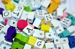 Craft colored beads and alphabet blocks jumble royalty free stock photography