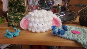 Craft Display. Knitted items on display, lamb hat royalty free stock photo