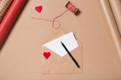Free Craft Envelope With Red Heart, Blank Paper And Pen On Beige Table. Wrapping. Love Concept. Saint Valentine`s Day Concept Stock Photography - 131933082