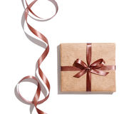 Craft gift box with curved brown ribbon Stock Photos