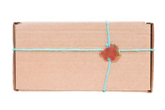 Craft gift box with decorative wax seal. Isolated on white, clipping path included royalty free stock photo