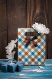 Craft gift box with lit candle Stock Image