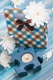 Craft gift box with lit candle Stock Photos