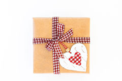 Craft gift box with ribbon, bow and heart isolated Royalty Free Stock Images