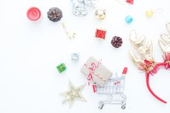 Craft gift box in shopping cart and Christmas gift boxes and decorations on white Royalty Free Stock Photos
